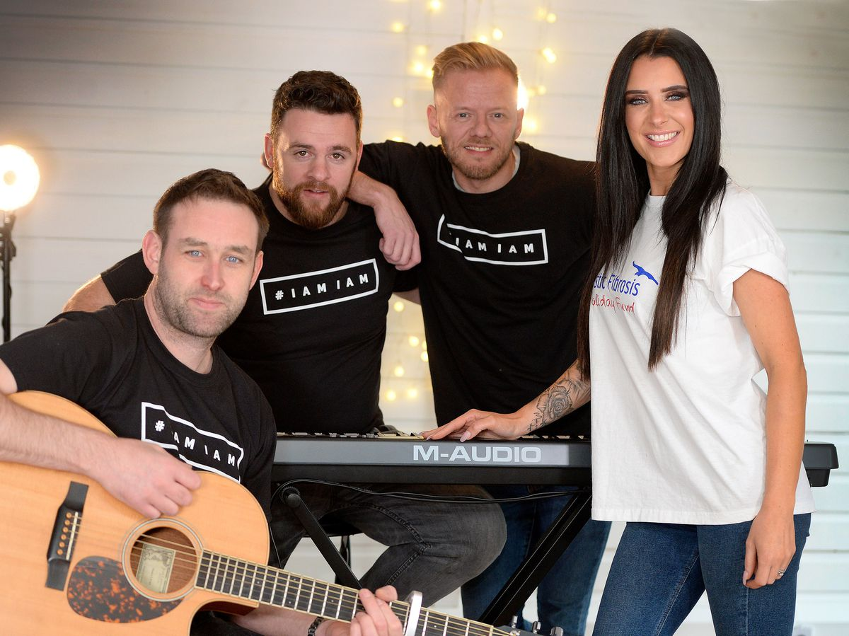 Singer Kat Richards with music producer Matt Bishop, keyboard player Chris Rushton and fellow music producer Marc Cotterill at Inspire Music Studios in Stone