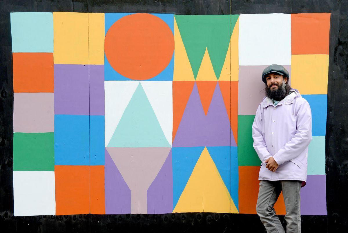 Vik Chandla with his Ow Am Ya artwork