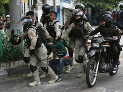 Indonesia's president says riots under control after six killed in violence