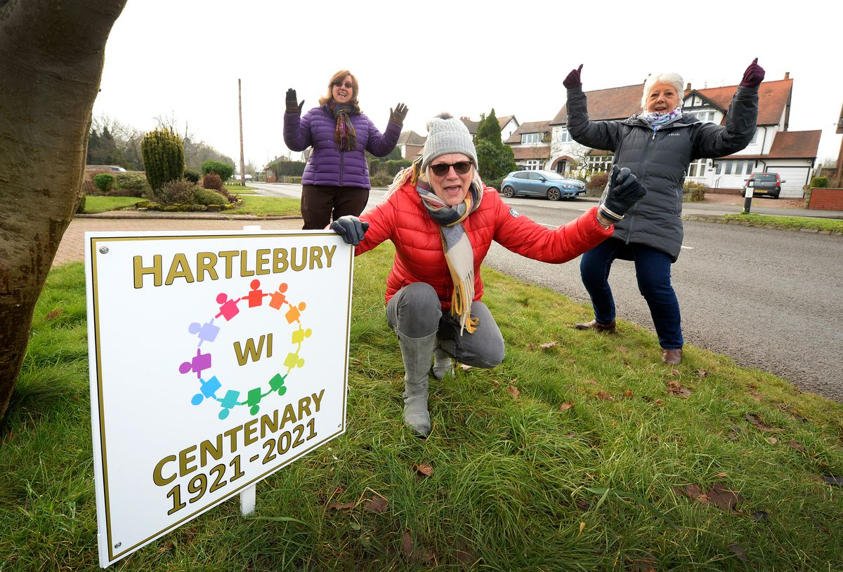 Marion Inman, Pauline Rice and Dawn Bradley, from Hartlebury Womens Institute celebrating their centenary by placing signs around Hartlebury