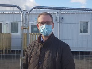 Councillor Nicholas Barlow infront of the test centre
