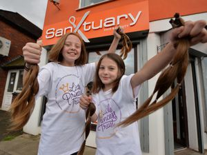 Raising money for the Little Princess Trust getting their hair cut, (left) Arla Farley, and Lottie Giles-Dawson, both aged 10, at Sanctuary hair and beauty, Aldridge.