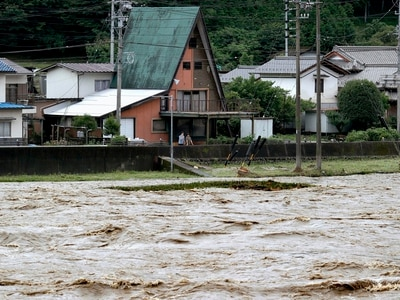 Japan battered by more heavy rain as floods death toll nears 60