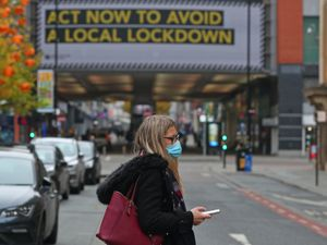 A woman wearing a face mask in Manchester city centre (Peter Byrne/PA)