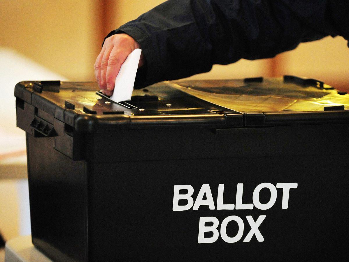 Man places vote in ballot box