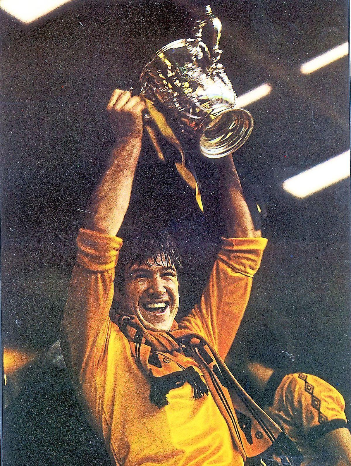 Wolves captain Emlyn Hughes raises League Cup trophy