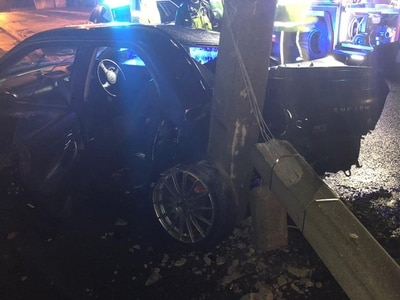 Driver flees as Subaru smashes into lamppost in high-speed crash