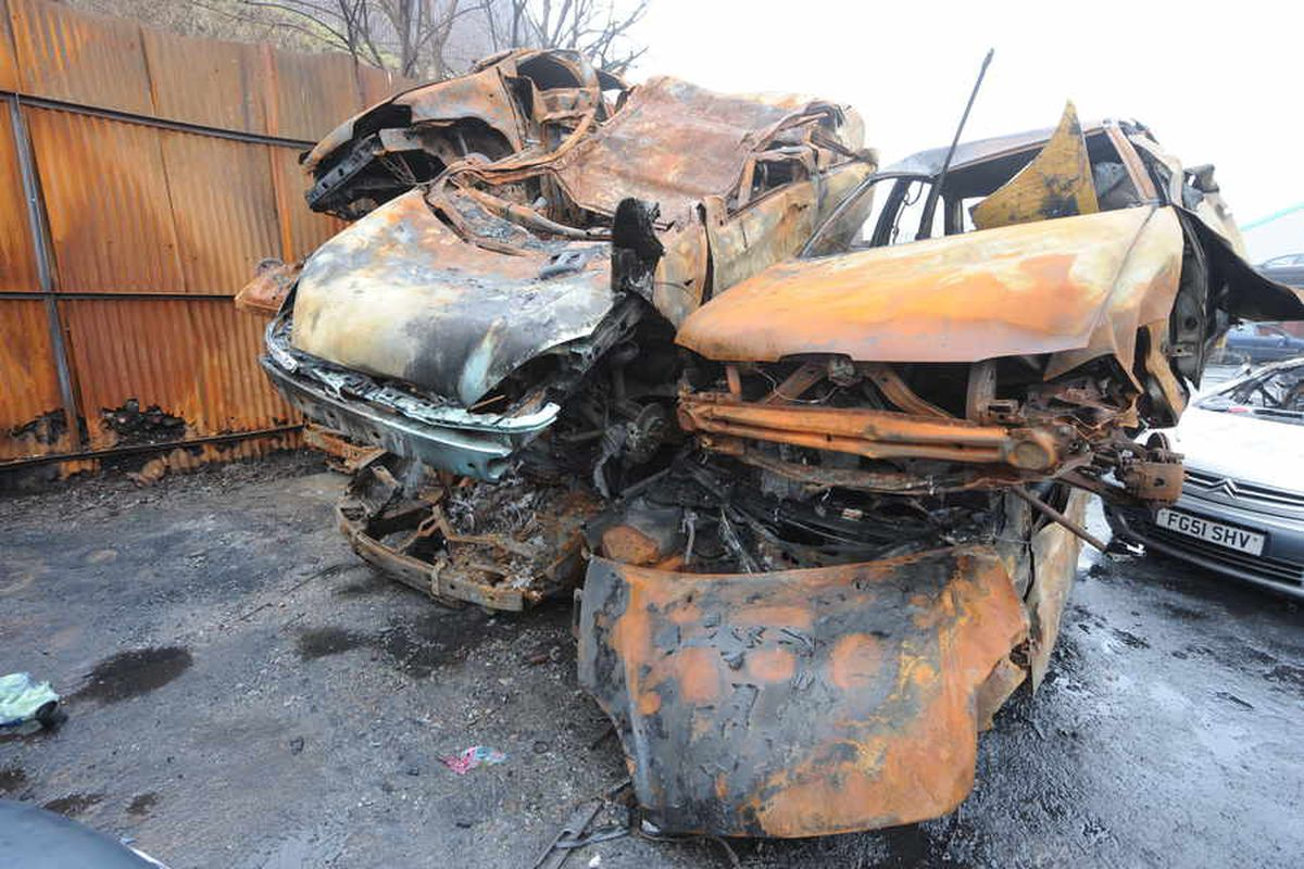 Dozens of vehicles on fire as arson attack hits scrap yard