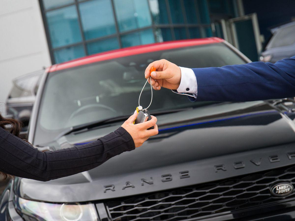 Dealer handing over keys