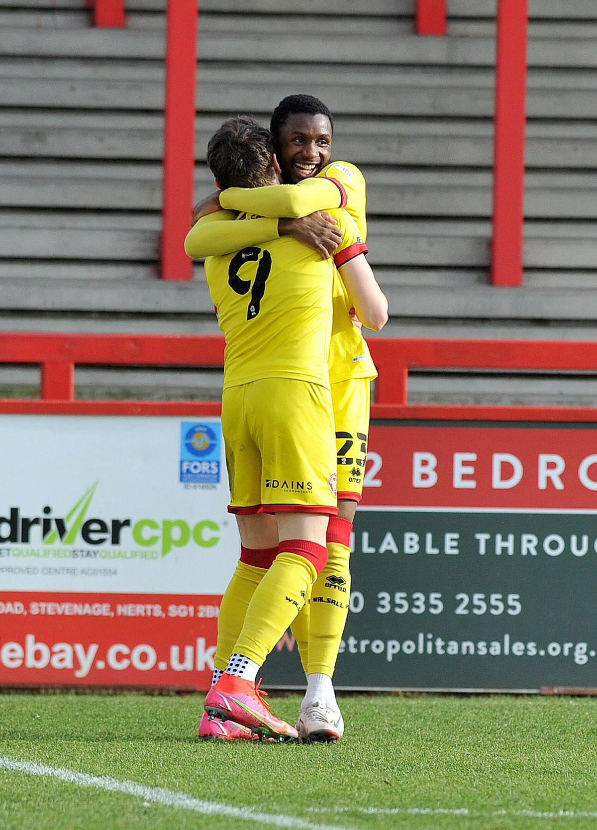 Caolan Lavery celebrates his early goal with Emmanuel Osadebe..