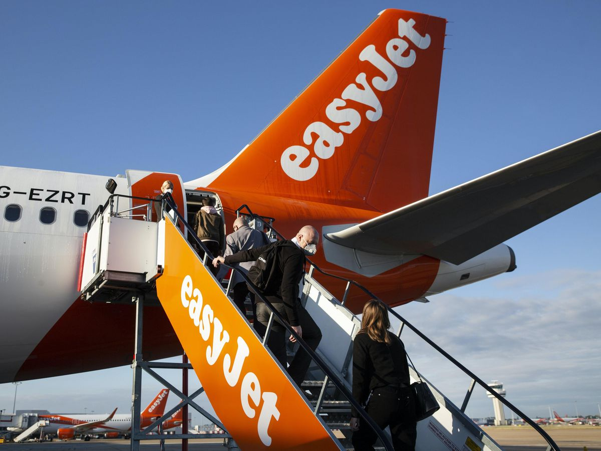 EasyJet has reported a spike in demand following the announcement that families will be allowed to reunite over the festive period (Matt Alexander/PA)