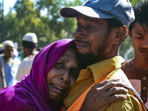 A Rohingya refugee woman who is among those being moved to an island called Bhasan Char cries outside a transit area (Shafiqur