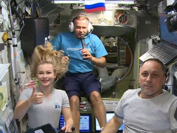 Actress Yulia Peresild, left, film director Klim Shipenko, centre, and cosmonaut Anton Shkaplerov aboard the ISS earlier this month