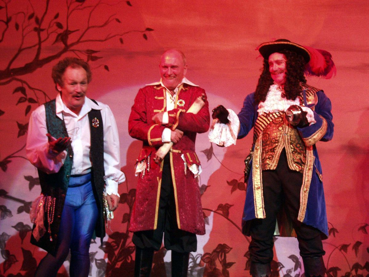 Bobby Ball, left, with Tommy Cannon, centre, during the Grand's Peter Pan pantomime in 2003. Tony Adams, better known as Adam Chance from Crossroads, is right.