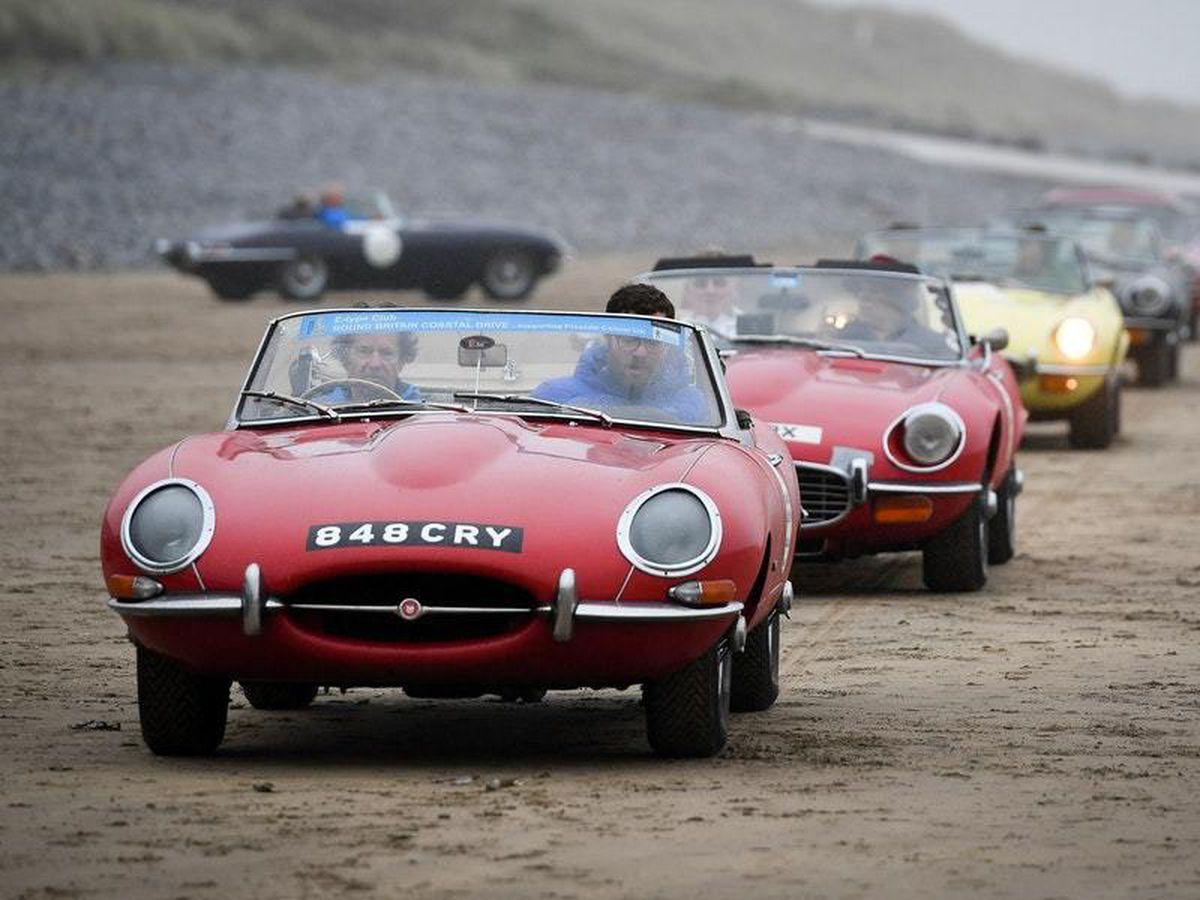 Jaguar cars on beach