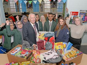 Principal Keith Whittlestone, along with pupils hand over donations to Louisa Langford from the charity Homeless Angels at Joseph Leckie Academy, Walstead Road West, Walsall, after a campaign at the school to help the local homeless.