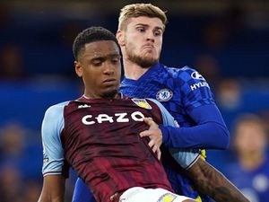 """Chelsea   s Timo Werner (top) and Aston Villa's Ezri Konsa battle for the ball during the Premier League match at Stamford Bridge, London. Picture date: Saturday September 11, 2021. PA Photo. See PA story SOCCER Chelsea. Photo credit should read: Adam Davy/PA Wire.   RESTRICTIONS: EDITORIAL USE  ONLY No use with unauthorised audio, video, data, fixture lists, club/league logos or """"live"""" services. Online in-match use limited to 120 images, no video emulation. No use in betting, games or single club/league/player publications."""