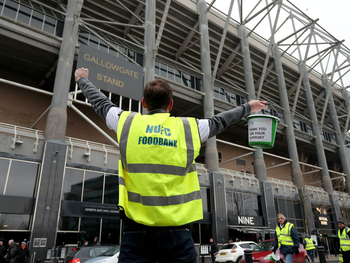 A man collects for the NUFC Food Bank before the Premier League match against Cardiff in January 2019