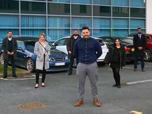 Outside 1st Choice Insurance Shrewsbury, Jupiter House. FRONT - Jamie Firkin, Sales Manager. BACK- Jaswant Kanth, Louise Lacey, Mohammed Yahseen, Kiran Bains and Jordy Nkunga, New Sales Executives