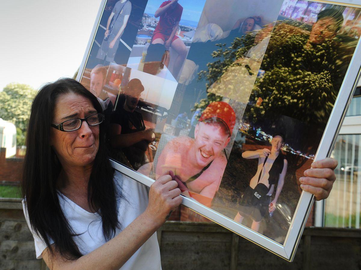 Dawn Bennett with photos of her son Shane Mayer who was murdered in Darlaston in 2019