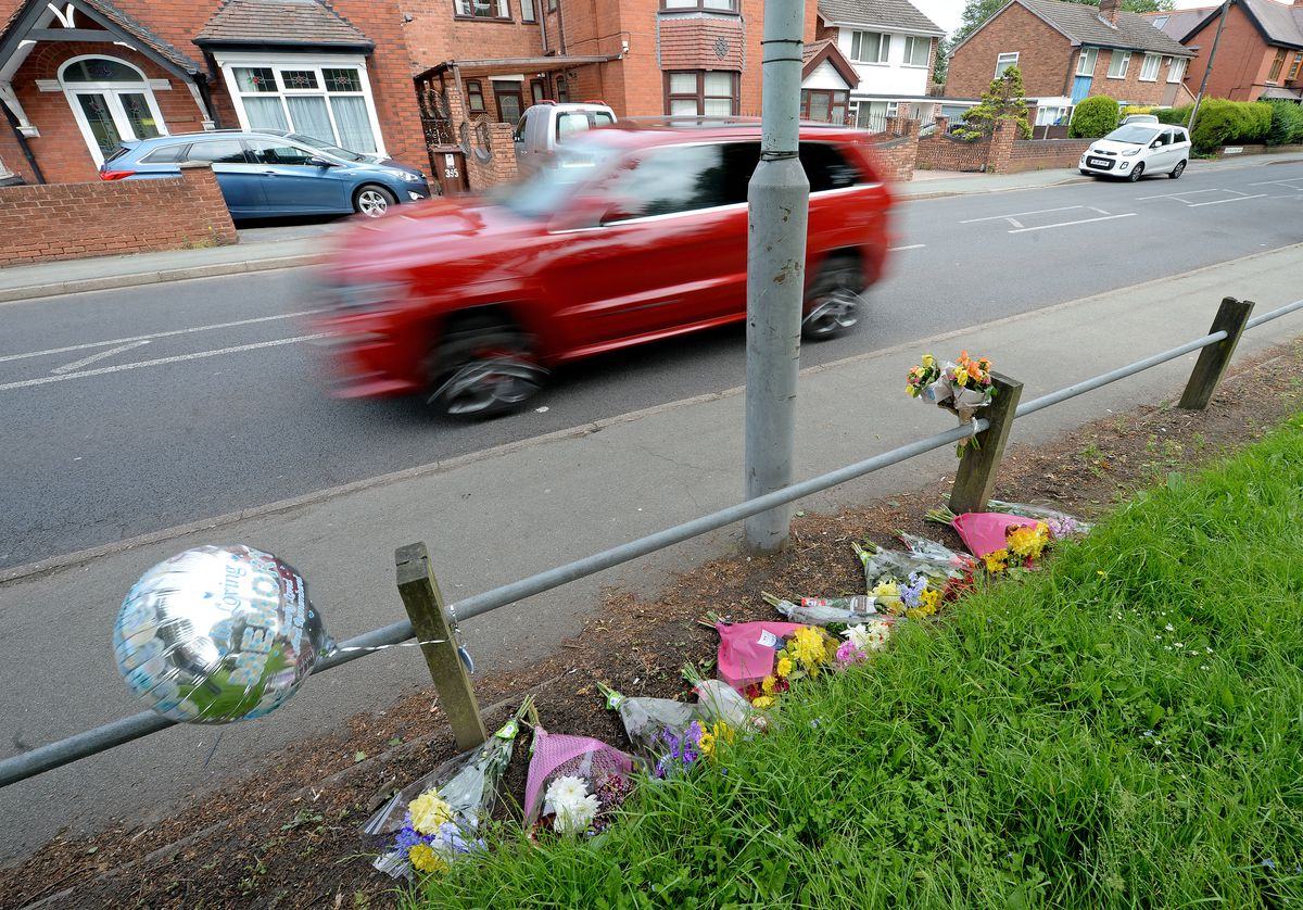 The scene on Prestwood Road, Wolverhampton, where tributes have been left for Shakur Pinnock