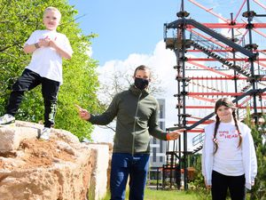 Bear Grylls with Alfie Donnelly, 8, and Rebecca Hampson, 11, from Young at Heart Photo: J Hordle / INhouse images