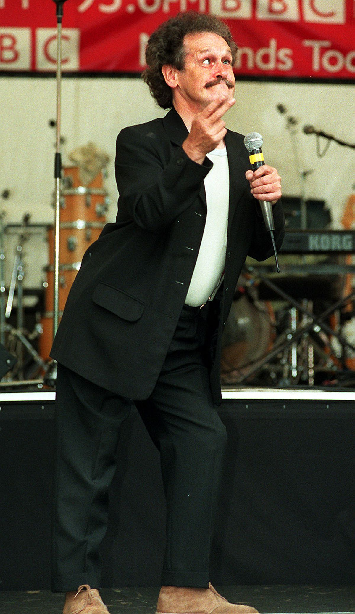 Bobby Ball entertains the crowds at a rain-soaked Dudley Show
