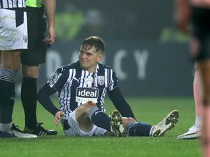 Conor Townsend of West Bromwich Albion is forced off injured.