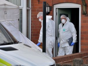 Forensic specialists at the scene in Broad Lane, Bloxwich