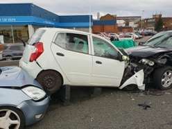Driver arrested after police chase ends in three-car crash