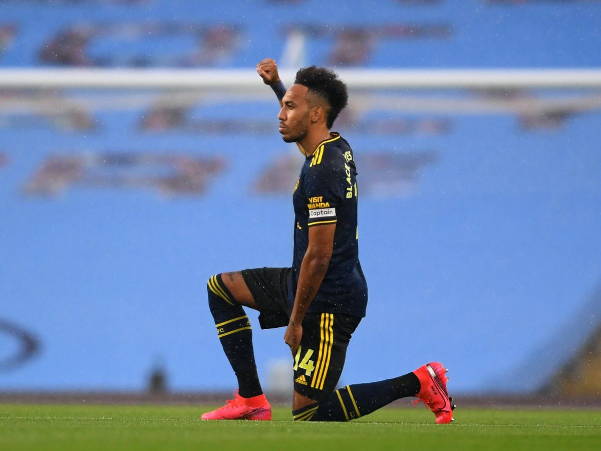 Arsenal's Pierre-Emerick Aubameyang takes a knee in support of the Black Lives Matter movement
