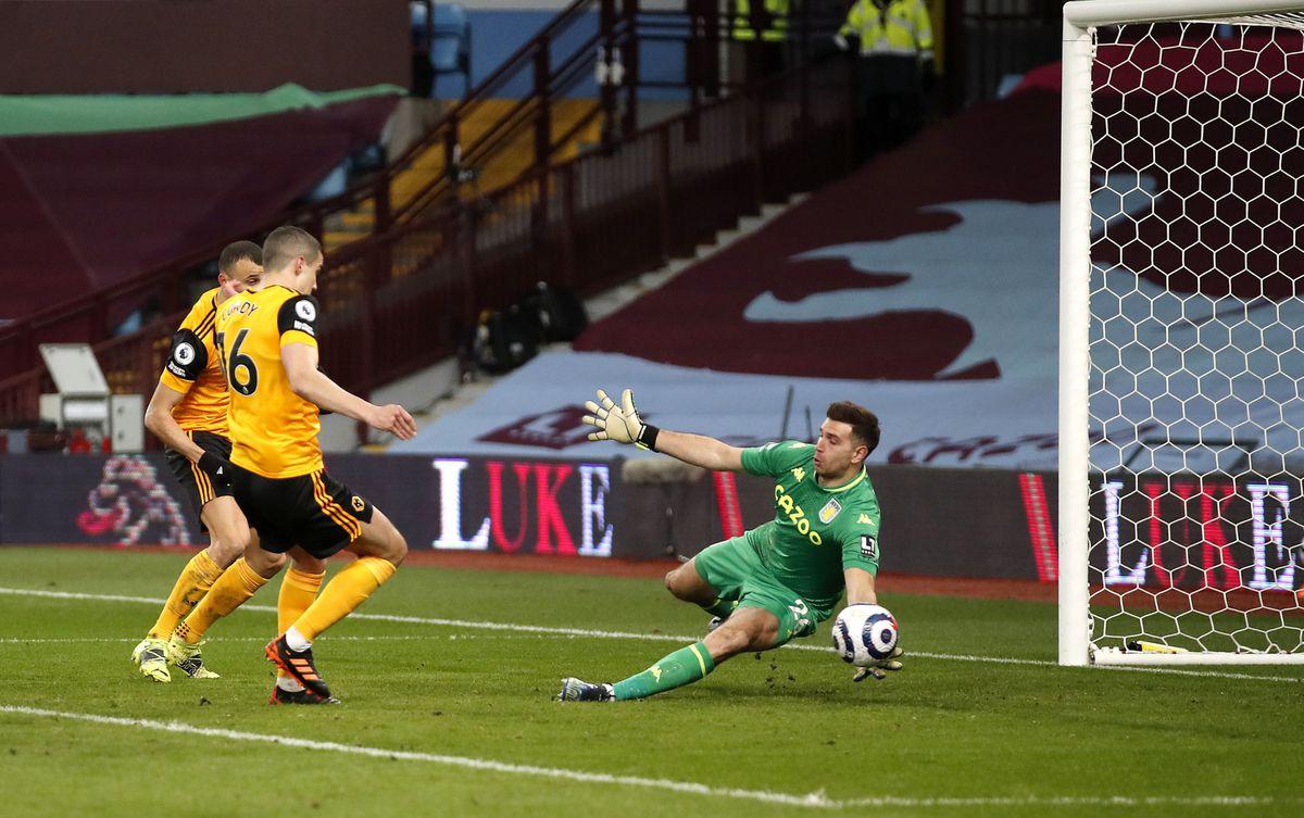 Wolverhampton Wanderers' Conor Coady (left) sees his shot saved by Aston Villa goalkeeper Emiliano Martinez
