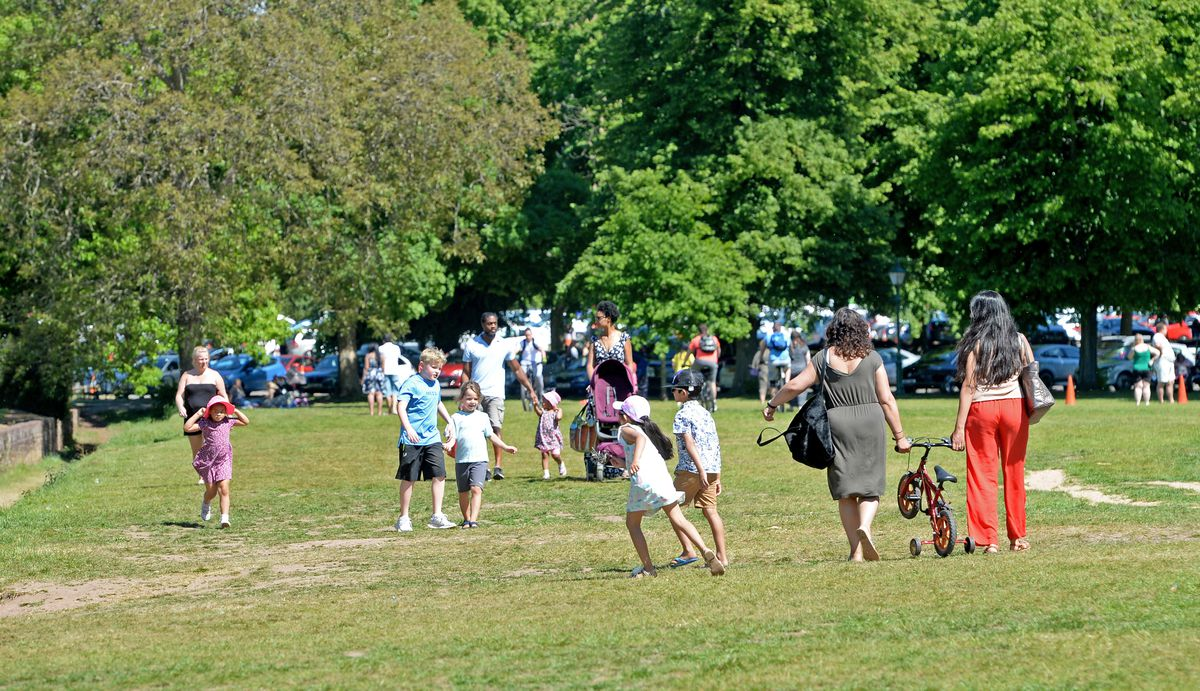 People enjoy the hot weather at Himley Park