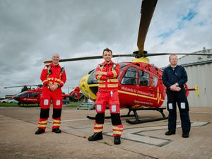 Ready for action at RAF Cosford – Air Ambulance paramedics Mike Andrews and Pete Edwards along with pilot Alastair Lees