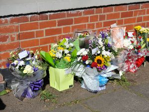 Tributes at the house on Broad Lane, Bloxwich, where Lee Gadd was found dead