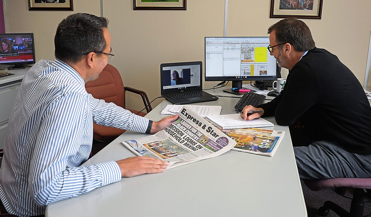 Editor Martin Wright, left, leads an editorial conference with others joining online