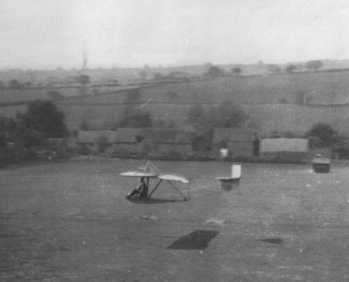 A very basic glider takes flight from Perton Ridge around the 1920s.