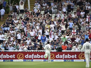 Supporters of England team cheer during the first day of the second cricket test match between England and New Zealand at Edgbaston in Birmingham, England, Thursday, June 10, 2021. (AP Photo/Rui Vieira).