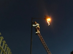 Man rescued after scaling 32ft lamppost 'had taken legal high'