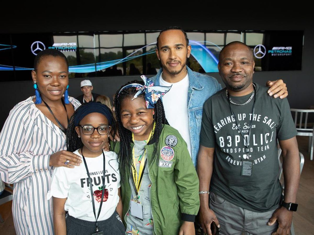 Chloe and her family with Lewis Hamilton