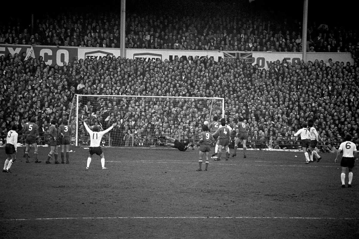 Derby County's Alan Hinton (fifth l) celebrates prematurely as Juventus goalkeeper Dino Zoff (c, diving) pushes his shot around the post.