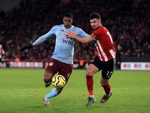 Aston Villa's Wesley (left)