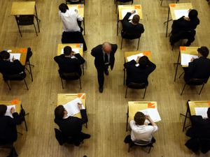 A general overhead view of pupils sitting an exam