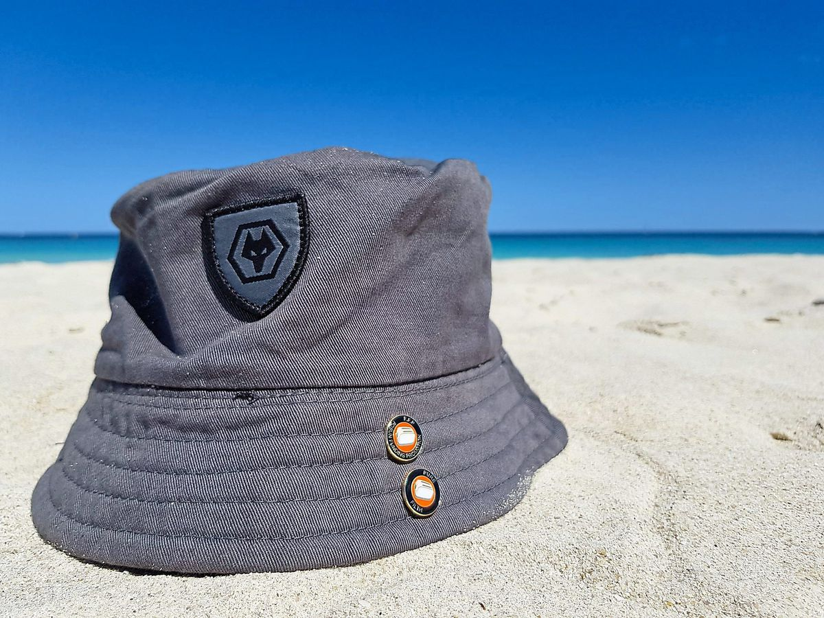 Wherever I lay my hat – a Wolves hat positioned on a sunny beach