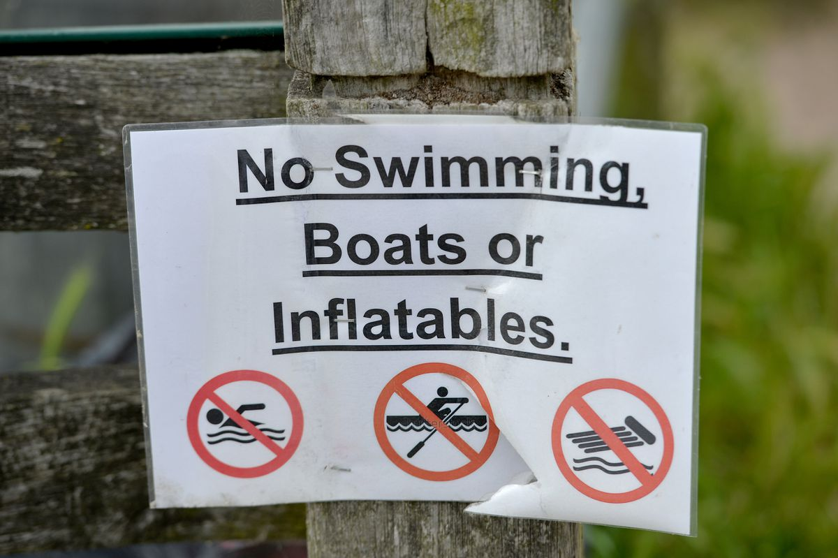 One of the signs pinned up at Chasewater warning against swimming in the reservoir