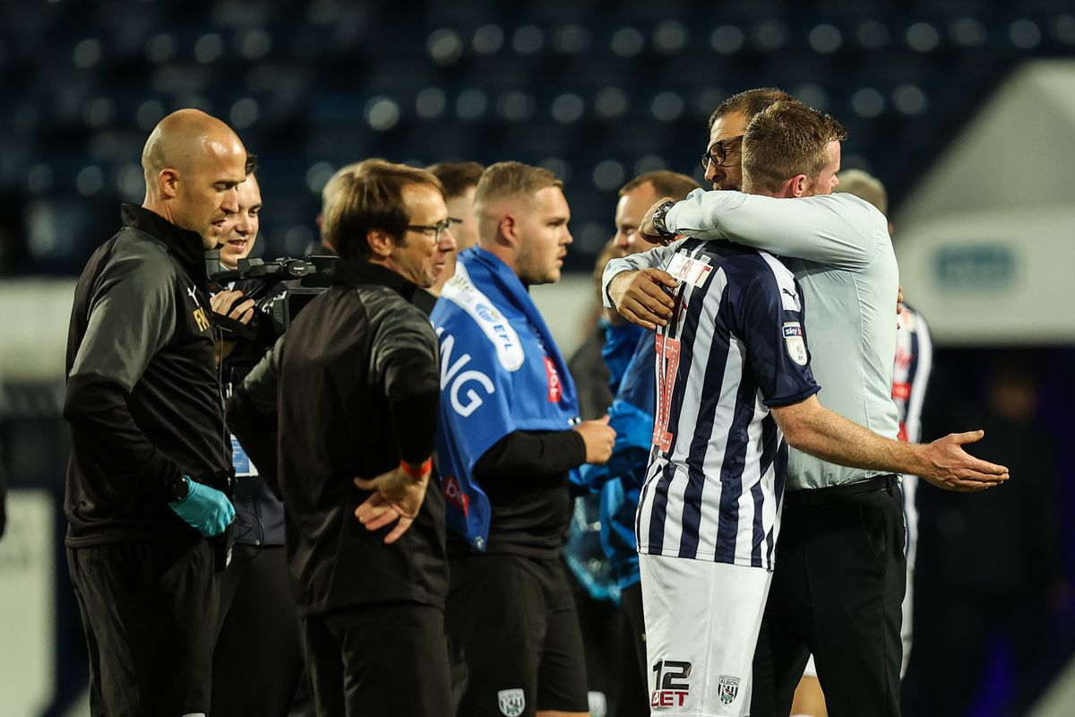 Chris Brunt of West Bromwich Albion and Slaven Bilic the head coach / manager of West Bromwich Albion at full time as promotion is confirmed. (AMA)