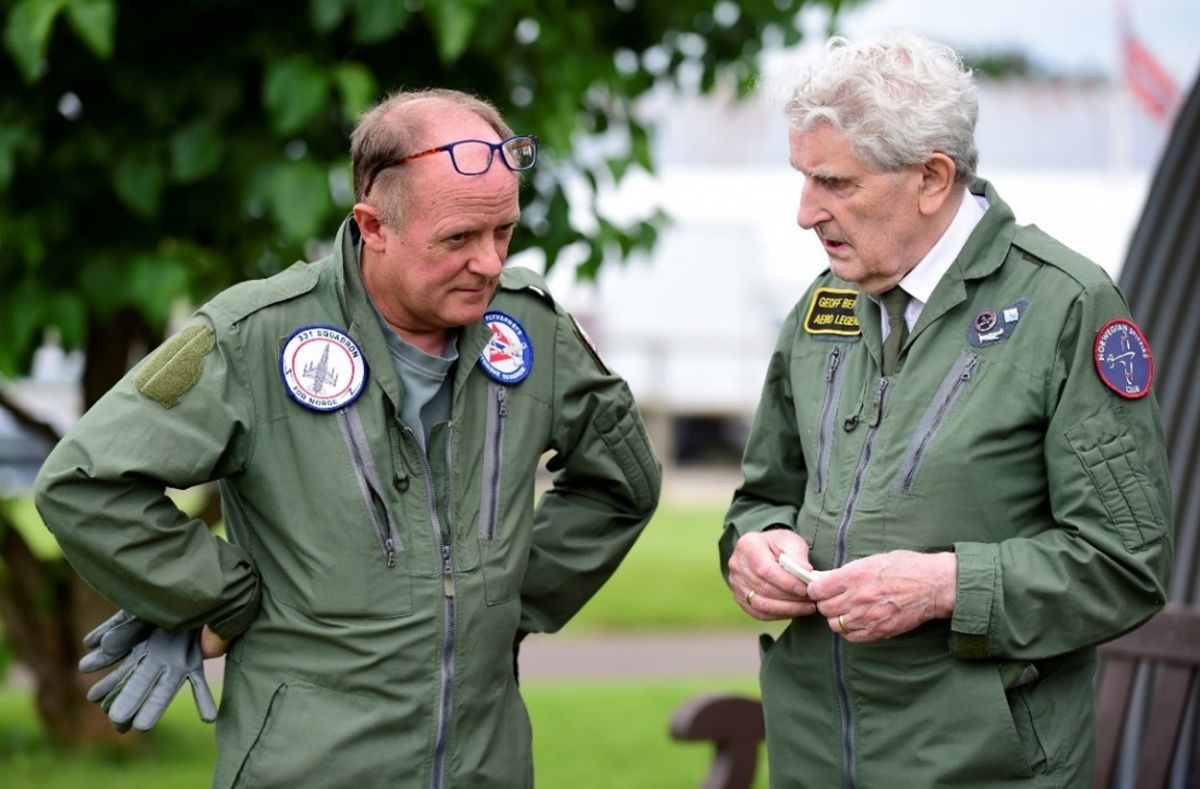 Geoff Berriman, right, chats to Keith Jones, who flew with the Harvard escort.