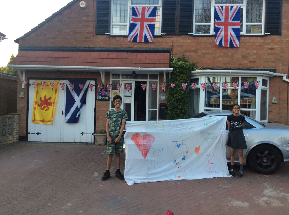 Alistair Singh, 13, and Grace Singh, 10, celebrate in Dudley