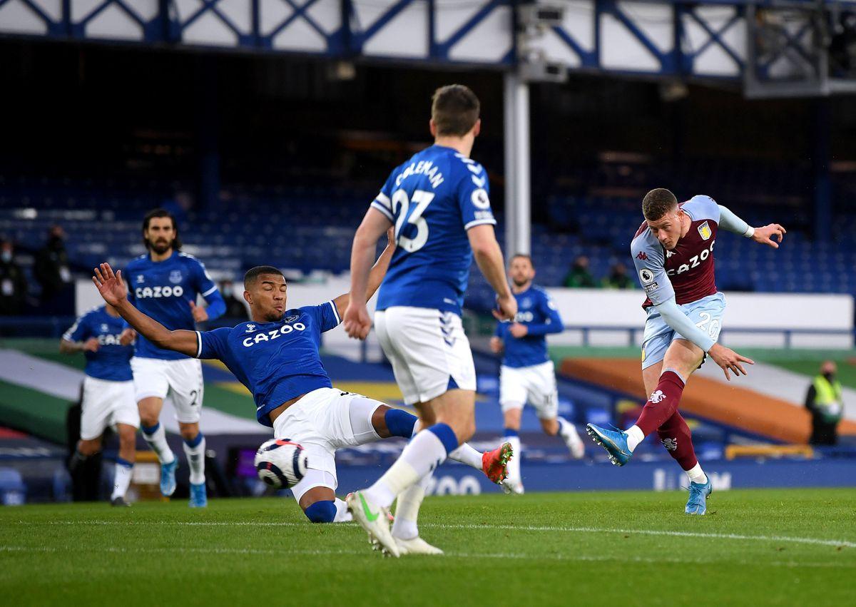 Aston Villa's Ross Barkley (right) sees his shot hit the post