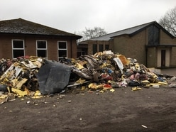Anger after huge pile of rubbish dumped outside church